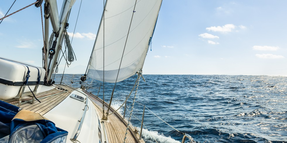 Yacht sail in the Atlantic ocean at sunny day cruise